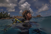 Michel Monthy, a marine officer with the Seychelles National Parks Authority, surfaces after diving during a coral relocation operation off of Curieuse, Seychelles on February 20, 2018. The coral relocation operation is an effort to reduce the effects of coral bleaching caused by the rise in sea temperatures which deeply affected shallow water reefs in parts of the Seychelles.<br /> <br /> The government of Seychelles has created 81,000 square miles of Marine Protected Areas as part of a conservation debt swap deal in an effort to shield marine ecosystems from unsustainable development and climate change while safeguarding its economy.