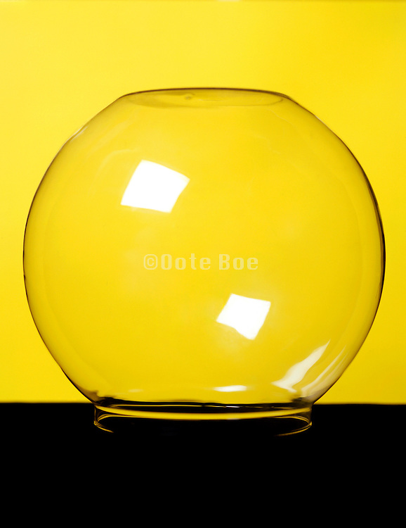 inverted glass bowl against yellow background