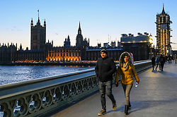 © Licensed to London News Pictures. 01/02/2020. LONDON, UK. Tourists cross Westminster Bridge as dusk falls over the Houses of Parliament in Westminster at the end of the first day following the UK leaving the European Union.   11 months of trade negotiations are to follow.  Photo credit: Stephen Chung/LNP
