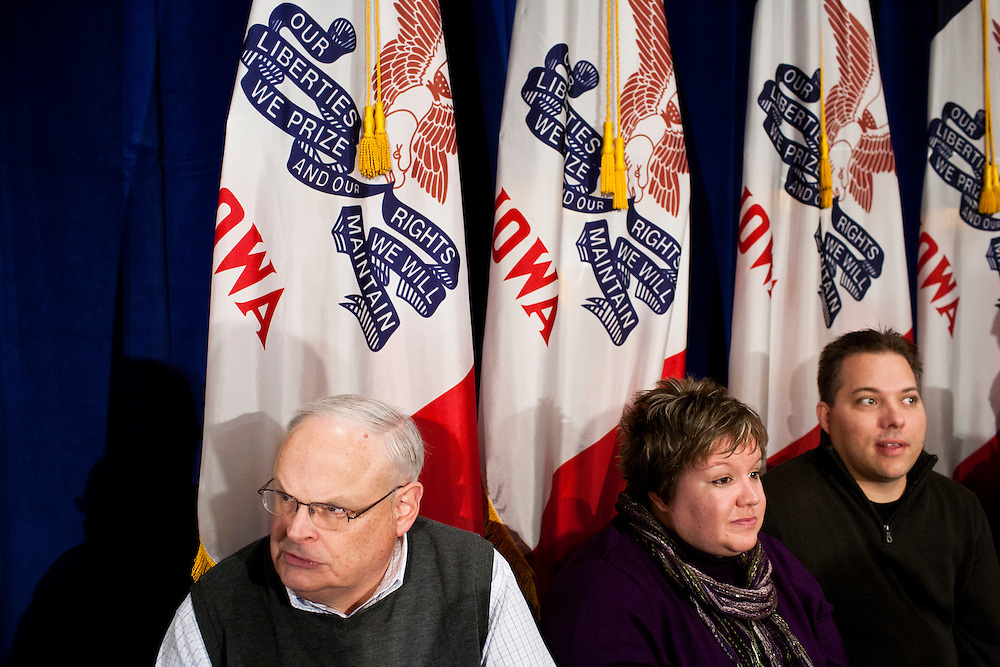 People wait for Republican presidential candidate Mitt Romney to arrive for a campaign rally on Tuesday, December 27, 2011 in Davenport, IA.