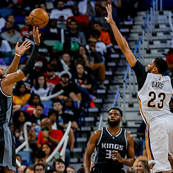Mar 31, 2017; New Orleans, LA, USA; Sacramento Kings guard Buddy Hield (24) shoots over New Orleans Pelicans forward Anthony Davis (23) during the second half of a game at the Smoothie King Center. The Pelicans defeated the Kings 117-89. Mandatory Credit: Derick E. Hingle-USA TODAY Sports