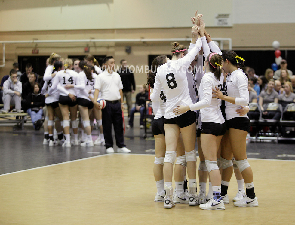 West Point, NY - Army players gather on the court before playing Lehigh in the Patriot League women's volleyball tournament at the United States Military Academy on  Nov. 21, 2009.