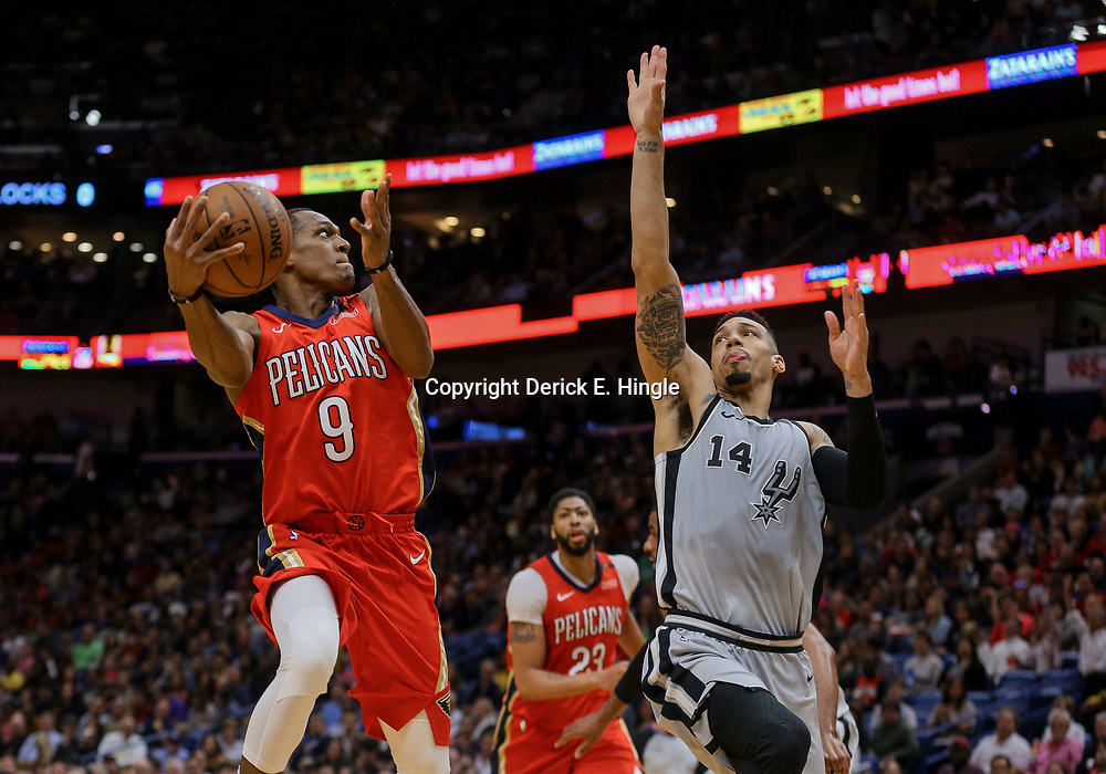 Apr 11, 2018; New Orleans, LA, USA; New Orleans Pelicans guard Rajon Rondo (9) shoots over San Antonio Spurs guard Danny Green (14) during the second quarter at the Smoothie King Center. Mandatory Credit: Derick E. Hingle-USA TODAY Sports