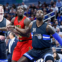 25 February 2017: Atlanta Hawks forward Taurean Prince (12) vies for the rebound with Orlando Magic forward Jeff Green (34) and Orlando Magic guard Mario Hezonja (8) during the Orlando Magic 105-86 victory over the Atlanta Hawks, at the Amway Center, Orlando, Florida, USA.