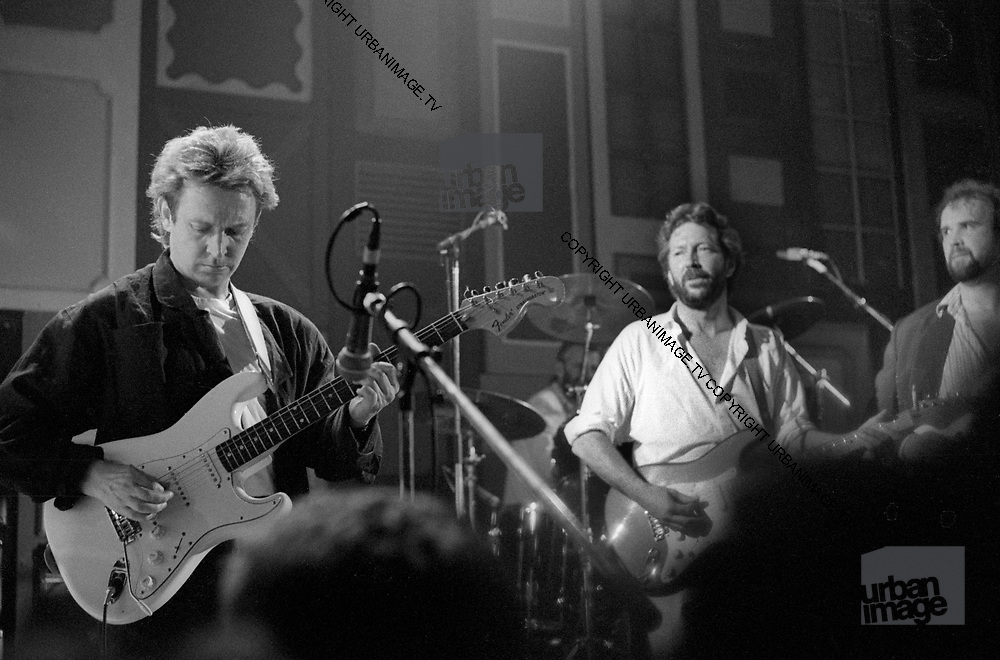 Eric Clapton jams with Andy Summersat the Island 25 party - London 1987