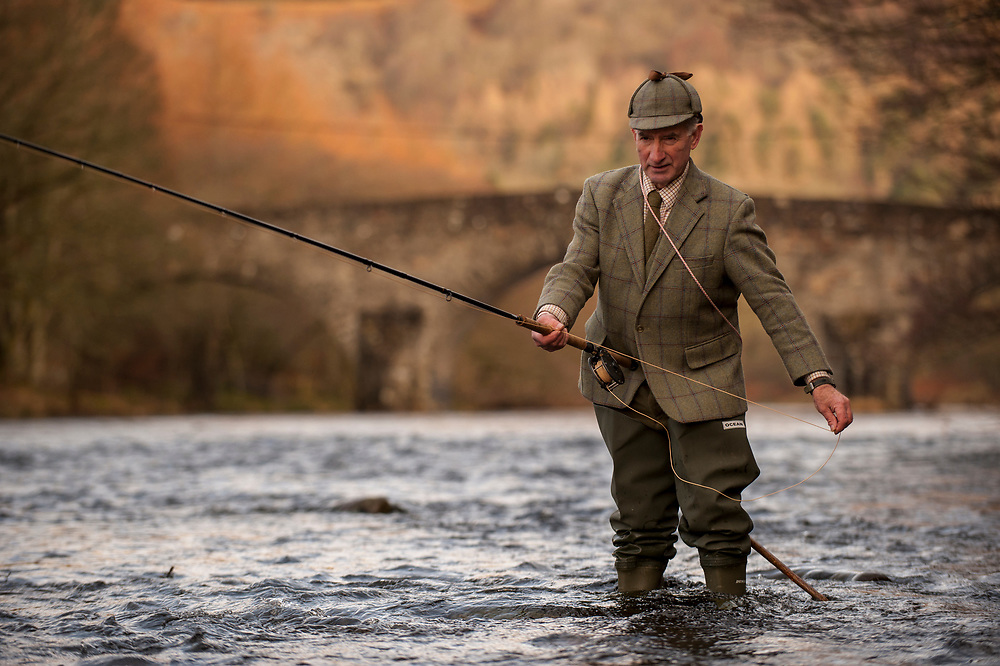 In Glenlyon on the River Lyon, Perthshire, Scotland.Fishing gillie for the Glenlyon Estate.Wearing the Glenlyon Estate tweed.  Fortingall Lodge, Scotland