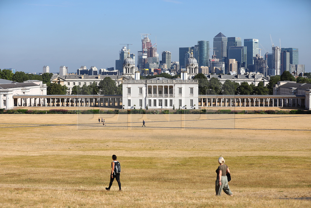 © Licensed to London News Pictures. 24/07/2018. London, UK. People in Greenwich Park at the start of another hot day in London. Record temperatures are expected to continue throughout the week. Photo credit: Rob Pinney/LNP