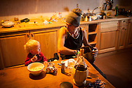 Beñat and Oihu eat some pop corns in the hut. Brontallo (Switterland) July 02, 2014. Beñat and Nathalie spend two months (July and August) on Spulüi, at 1.900 meters, taking care of goats and making cheese. Their children Kemen (7 years old) and Oihu (18 months) are with them. (Gari Garaialde / Bostok Photo)