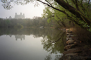 The Lake in Central Park and the Beresford apartments on a rare misty morning; New York City.
