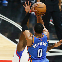02 November 2016: Oklahoma City Thunder guard Russell Westbrook (0) takes a jump shot over Los Angeles Clippers forward Brandon Bass (30) during the Oklahoma City Thunder 85-83 victory over the Los Angeles Clippers, at the Staples Center, Los Angeles, California, USA.