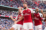 Arsenal forward Lacazette (9), Arsenal defender Nacho Monreal (18), Arsenal forward Olivier Giroud (12) celebrate win  the FA Community Shield match between Arsenal and Chelsea at Wembley Stadium, London, England on 6 August 2017. Photo by Sebastian Frej.