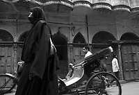 A muslim woman passing in the streets of Old Delhi, India