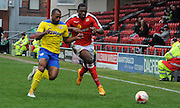 Lanre Oyebanjo and Anthony Grant tuslle for posessionduring the Sky Bet League 1 match between Crewe Alexandra and Crawley Town at Alexandra Stadium, Crewe, England on 3 April 2015. Photo by Michael Hulf.