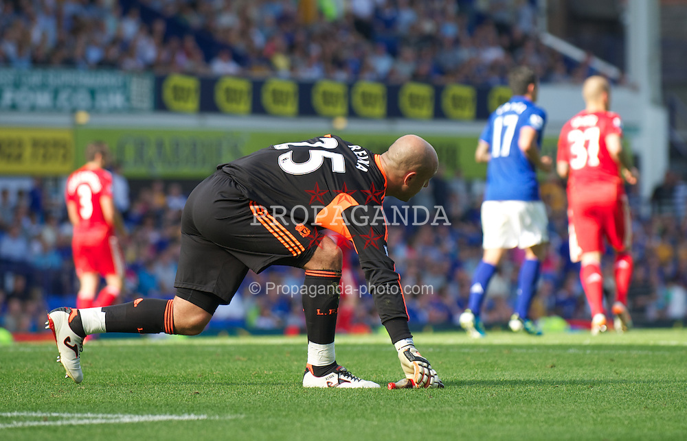 LIVERPOOL, ENGLAND - Saturday, October 1, 2011: Liverpool's goalkeeper Jose Reina picks up a bottle that was thrown at him by Everton supporters during the Premiership match at Goodison Park. (Pic by David Rawcliffe/Propaganda)
