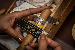 A person works in the girdling of a limited edition tobacco for the 50th anniversary of Cohiba brand during the 18th International Habano Cigar Festival, at the Cohiba tobacco factory, in El Laguito, Havana, Cuba, on March 3, 2016. The 18th International Habano Cigar Festival is held from Feb. 29 to March 4. EXPA Pictures © 2016, PhotoCredit: EXPA/ Photoshot/ Joaquin Hernandez<br />