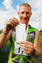 Padraig Marrey 1st place in Gaelforce West 2010 with his timeslip from the race..Pic Conor McKeown