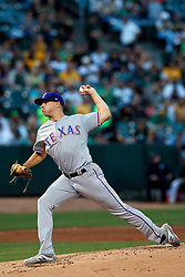 OAKLAND, CA - SEPTEMBER 21:  Brock Burke #70 of the Texas Rangers pitches against the Oakland Athletics during the first inning at the RingCentral Coliseum on September 21, 2019 in Oakland, California. The Oakland Athletics defeated the Texas Rangers 12-3. (Photo by Jason O. Watson/Getty Images) *** Local Caption *** Brock Burke