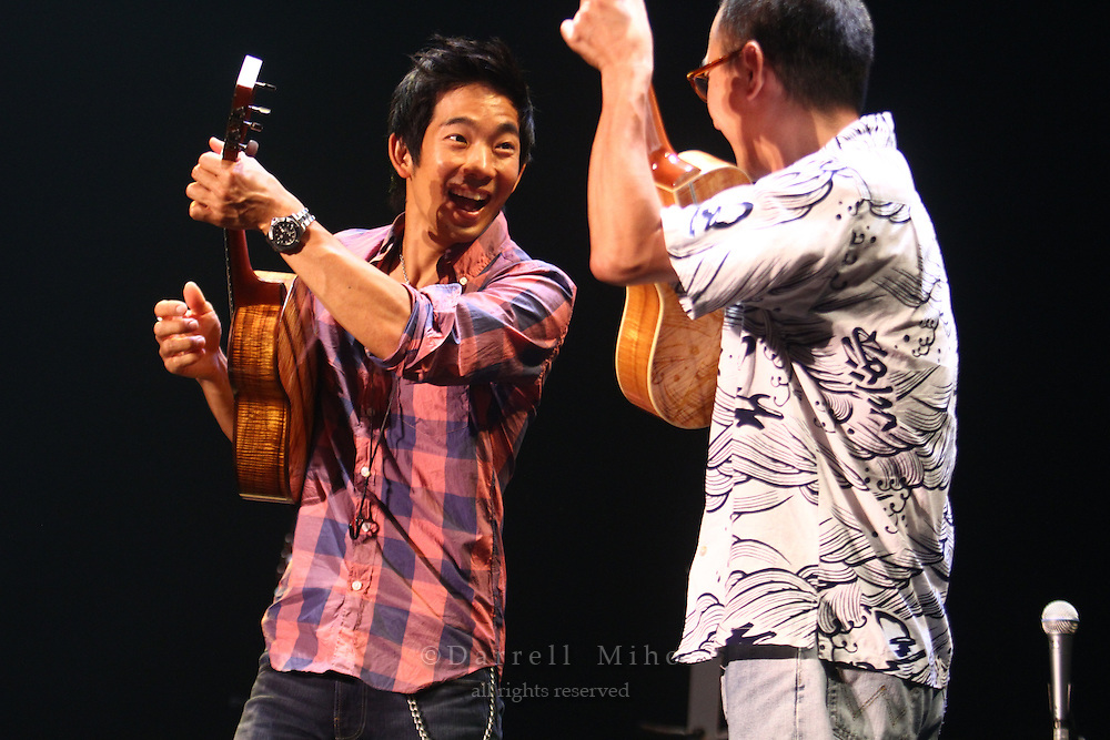 "Aug. 17, 2010 ; Kanazawa, JPN - Sound check with guest ukulele player Ken Kawai. Jake Shimabukuro at the Hokkoku Shimbun Akabane Hall during the ""I Love Ukulele Tour 2010""."