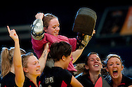 Sixteen years old keeper Amy Tennant (C) of Bowdown Hightown celebrates with teammates, after saving the last penalty of the macth, and wining the women's final of the Super Sixes National Indoor Hockey Finals..Bogdan Maran (1989)
