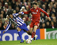 Photo: Paul Greenwood/Sportsbeat Images.<br />Liverpool v Porto. UEFA Champions League. 28/11/2007.<br /> Poto's Bruno Alves, left, and Fernando Torres tussle for the ball