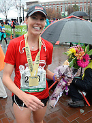 Publix Georgia Marathon female winner Kaye Starosciak, of Canton, Ga., holds a bouquet of flowers after her victory Sunday, March 22, 2015, in Atlanta. David Tulis / AJC Special