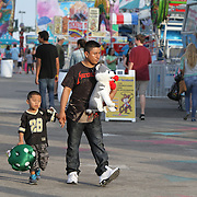 Food and rides are the main attraction around the midway of the South Florida State Fair.<br /> Photography by Jose More