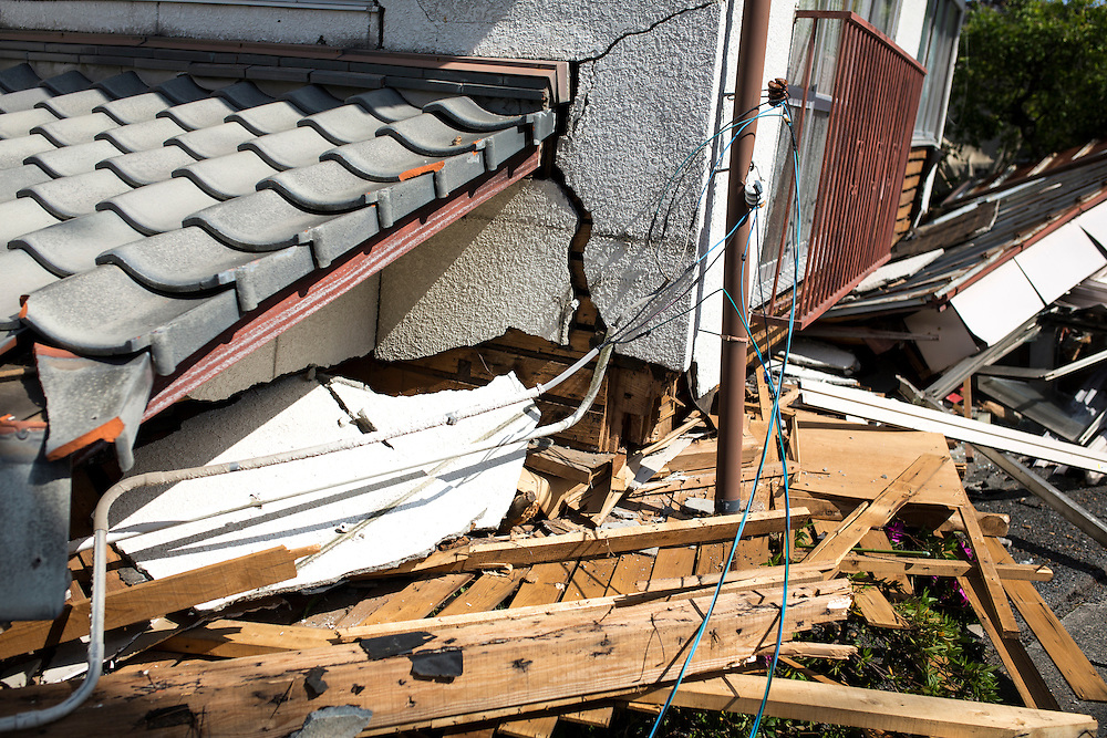 KUMAMOTO, JAPAN - APRIL 20: A collapsed house after an earthquake is seen in the morning on April 20, 2016 in Mashiki Gymnasium parking area, Kumamoto, Japan. As of April 45 people were confirmed dead after strong earthquakes rocked Kyushu Island of Japan. Nearly 11,000 people are reportedly evacuated after the tremors Thursday night at magnitude 6.5 and early Saturday morning at 7.3.<br /><br />Photo: Richard Atrero de Guzman