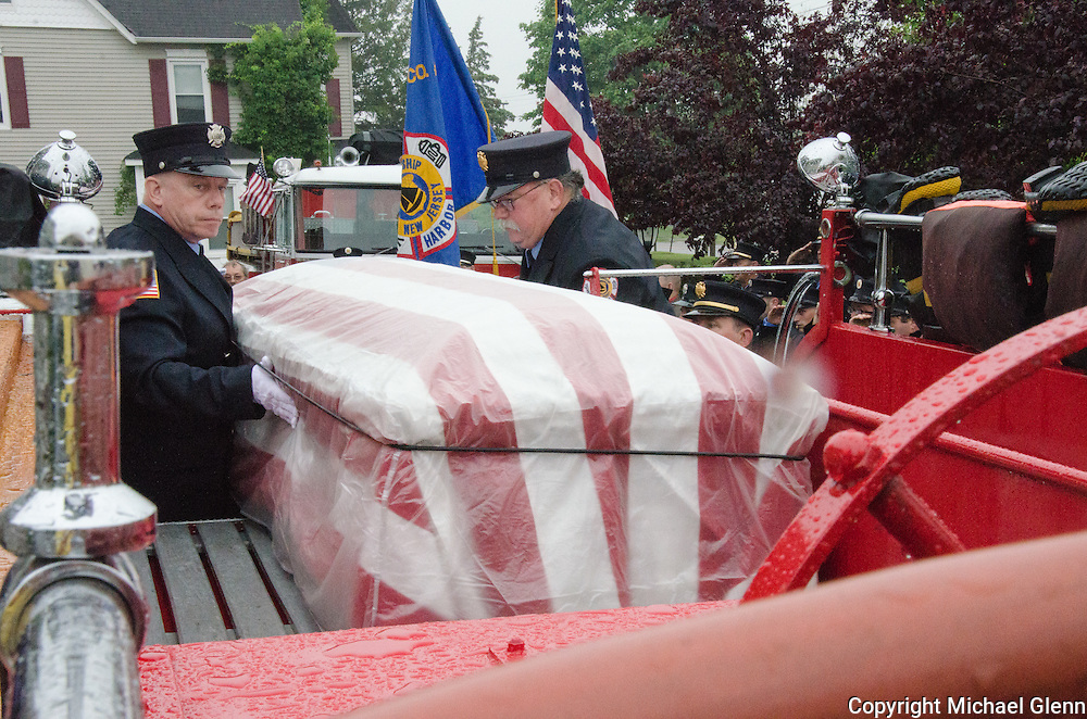 10Jun2013/Lanoka Harbor/NJ/USA/Casket of LHFD Chief Kevin Perrone is carried to awaiting fire truck for march to the fire house ceremony