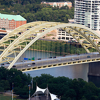 Photo of the yellow Daniel Carter Beard Bridge in Cincinnati, Ohio in the United States. Also called the Big Mac Bridge, it crosses the Ohio River to connect Cincinnati and Newport Kentucky. Photo is high resolution and was taken in 2012.