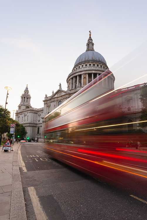 facade of St Pauls Cathedral with red London bus