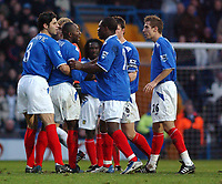 Fotball<br /> England 2004/22005<br /> Foto: SBI/Digitalsport<br /> NORWAY ONLY<br /> <br /> Portsmouth v Blackburn Rovers<br /> 15/1/2005<br /> Barclays Premiership<br /> <br /> Portsmouth's Lua Lua talks with team mates after being shown the red card.