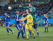Sam Johnson (Halifax) punches the ball clear during a Guiseley attack during the Conference Premier League match between FC Halifax Town and Guiseley at the Shay, Halifax, United Kingdom on 5 December 2015. Photo by Mark P Doherty.