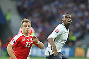 Switzerland Midfielder Xherdan Shaqiri and France Midfielder Paul Pogba during the Euro 2016 Group A match between Switzerland and France at Stade Pierre Mauroy, Lille, France on 19 June 2016. Photo by Phil Duncan.