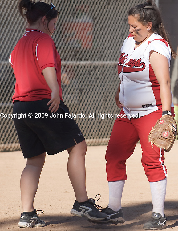 LBCC Coach Liz Sequira(l) and Valentina Nabayan(r) tap shoes to start off the seventh inning in the game against Mt. SAC at the LAC softball field on Tuesday April 21, 2009.  The Vikings lose the final regular season home game 5-1.