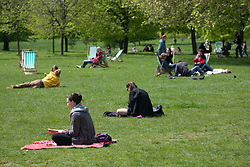 © licensed to London News Pictures. London, UK 12/05/2012. People picnicking in Hyde Park, as they enjoying warm weather today (12/05/12). Photo credit: Tolga Akmen/LNP