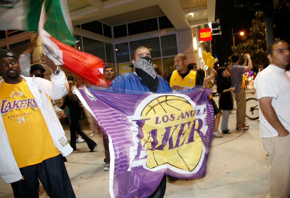 Fans of the Los Angeles Lakers celebrate their victory in the 2010 NBA Finals Championship against the Boston Celtics outside the Staples Center in Los Angeles California, USA, 17 June 2010.