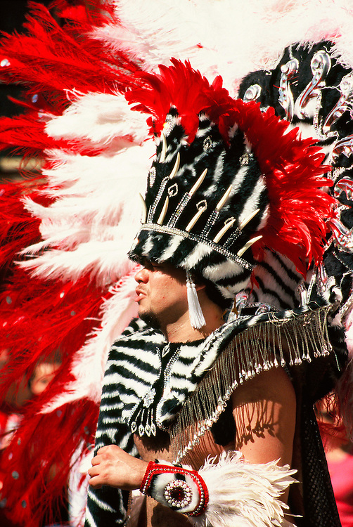 A man dresses in costume to take part in the annual Notting Hill Carnival, London.