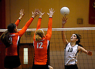 1 Nov. 2011 -- EDWARDSVILLE, Ill. -- Edwardsville High School girls' volleyball players  Samantha Epenesa (9) and Hannah Frierdich (12) leap to block a tip by Belleville West High School's Emily Becker (19) during the IHSA Class 4A girls volleyball sectional semifinal at Edwardsville High School in Edwardsville, Ill. Tuesday, Nov. 1, 2011. Edwardsville won, 2-1. Photo © copyright 2011 Sid Hastings.