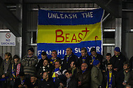 AFC Wimbledon fans display a banner that reads 'UNLEASH THE BEAST' during the FA Cup match at the Cherry Red Records Stadium, Kingston<br /> Picture by David Horn/Focus Images Ltd +44 7545 970036<br /> 05/01/2015