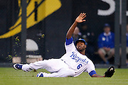 Kansas City Royals right fielder Lorenzo Cain (6) lunges for a ball hit by Cleveland Indians' Asdrubal Cabrera in the third inning of a baseball game against the Kansas City Royals at Kauffman Stadium in Kansas City, Mo., Tuesday, June 10, 2013. Cabrera singled on the play. (AP Photo/Colin E. Braley)