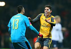 Gabriel Paulista of Arsenal celebrates with goalkeeper David Ospina after Giroud's late winning goal  - Mandatory by-line: Matt McNulty/JMP - 07/01/2017 - FOOTBALL - Deepdale - Preston, England - Preston North End v Arsenal - Emirates FA Cup third round