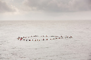 Charleston area surfers join hands in a floating circle during a traditional memorial paddle out to honor and remember the nine people killed at the historic mother Emanuel African Methodist Episcopal Church June 27, 2015 in Folly Beach, South Carolina. Earlier in the week a white supremacist gunman killed 9 members at the historically black church.