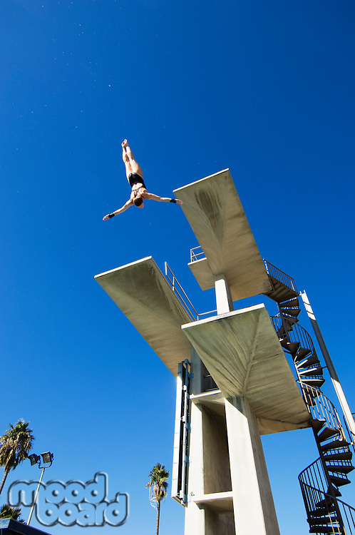 Swimmer diving from diving board