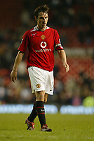 Photo: Aidan Ellis.<br /> Manchester United v Everton. The Barclays Premiership.<br /> 11/12/2005.<br /> United captain Gary Neville walks off dejected at the end