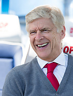 Arsene Wenger of Arsenal looks happy whilst sitting on the bench before the Premier League match at the John Smiths Stadium, Huddersfield<br /> Picture by James Wilson/Focus Images Ltd 07522 978714<br /> 13/05/2018