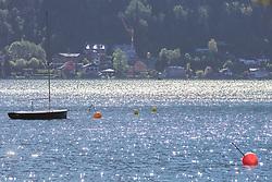 THEMENBILD - ein Segelboot ankert im Zeller See, welcher im Sonnenschein glitzert, aufgenommen am 19. Mai 2019, Zell am See, Österreich // a sailboat anchors in the Zeller lake, which glitters in the sunshine on 2019/05/19, Zell am See, Austria. EXPA Pictures © 2019, PhotoCredit: EXPA/ Stefanie Oberhauser