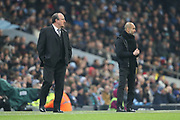 Rafael Benitez and Pep Guardiola during the Premier League match between Manchester City and Newcastle United at the Etihad Stadium, Manchester, England on 20 January 2018. Photo by George Franks.