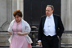 © Licensed to London News Pictures. 03/06/2019. London, UK. Nigel Dodds (right) arrives at Buckingham Palace to attend a State Banquet with the Queen, which the President of the United States of America Donald Trump will attend. Simultaneously, anti-Trump demonstrators protest outside at Buckingham Palace. Photo credit : Tom Nicholson/LNP