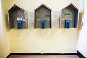 The three telephones for prisoners to use on Benbow wing inside HMP/YOI Portland, a resettlement prison with a capacity for 530 prisoners. Dorset, United Kingdom.