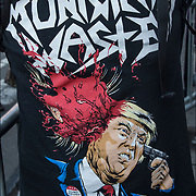 Close up of Dumpi Trump T-Shirt, with gun to his head, firing and blood coming out the other side.